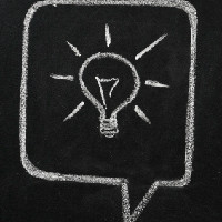 Light bulb drawn on a blackboard, symbolizing ideas and creativity